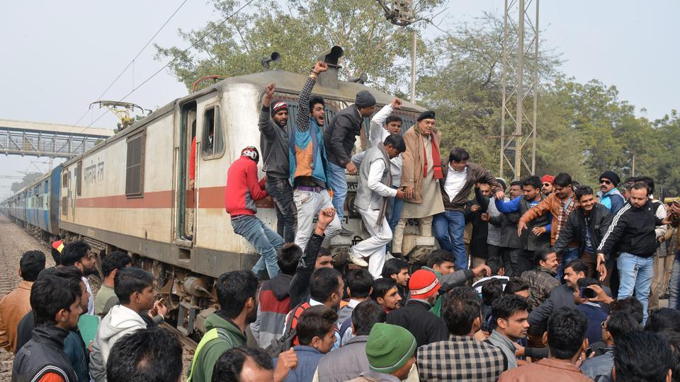 A group of people stopped a train at Bhuteshwar railway station during protests against the film 'Padmaavat', in Mathura. Several incidents of violent protests are being reported in different parts of the nation against the release of the movie. (AFP)