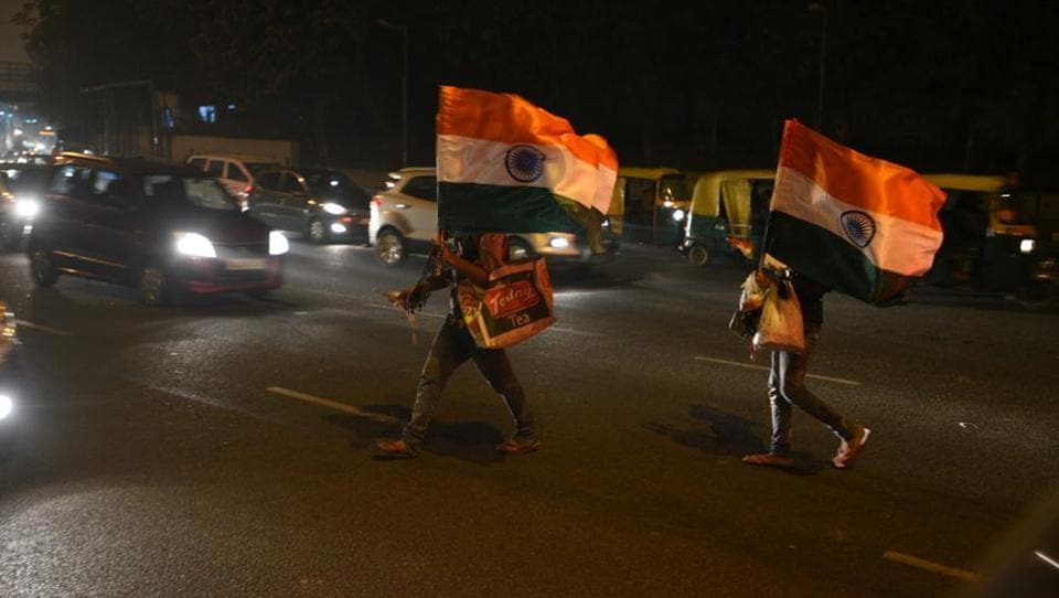 People selling Indian flag ahead of Republic Day a red light in New Delhi India, on January 24.