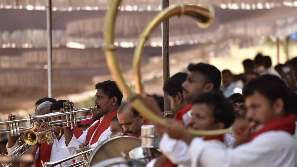A band performs during a buffalo race in Karnataka. In the midst of the debate between legalization and bans on the race, the sport has been growing in popularity among locals and is seen as a form of celebration to propitiate the gods for a good harvest. (Arijit Sen / HT Photo)