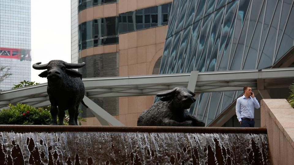 Sculptures of buffalos outside the Hong Kong Exchanges at the financial Central district, Hong Kong, China