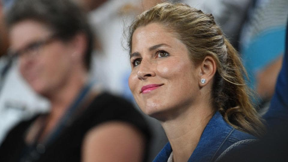 Mirka Federer, wife of Switzerland's Roger Federer, smiles as he celebrates beating Czech Republic's Tomas Berdych. (AFP)