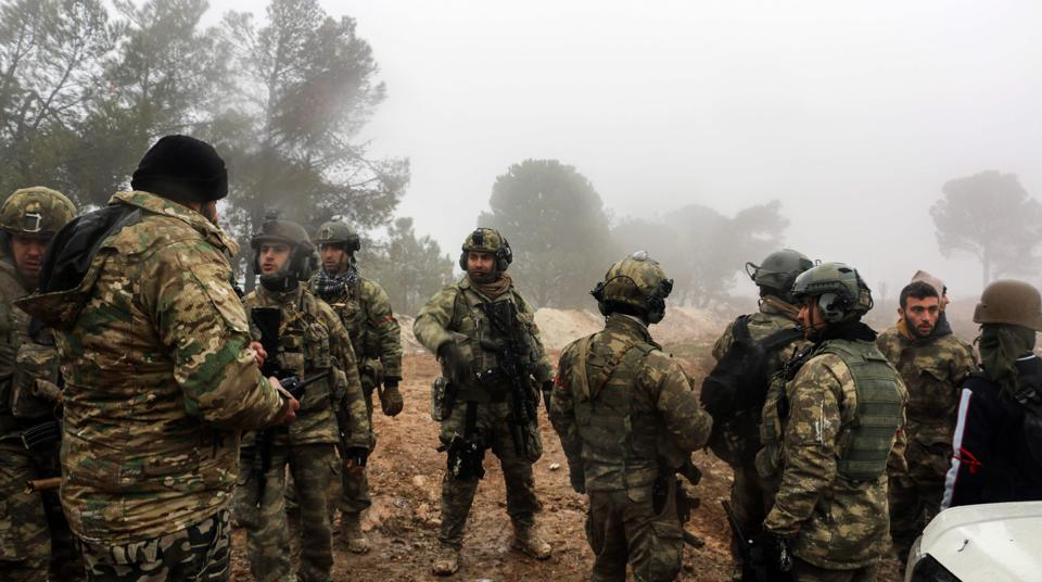 Turkish soldiers are seen around the area of Mount Bersaya, north of the Syrian town of Azaz near the border with Turkey, on January 23, 2018.