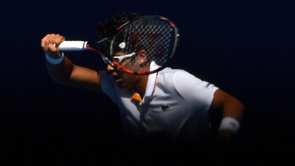 South Korea's Chung Hyeon hits a return against Tennys Sandgren of the US during their men's singles quarterfinalmatch on day 10 of the Australian Open tennis tournament in Melbourne on Wednesday.