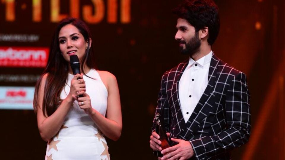 Shahid Kapoor, who wore a chequered Gaurav Gupta suit, and Mira Rajput, in a body-hugging cream coloured dress, dazzled on the stage too just like the couple stood out on the red carpet.  (ht photo)