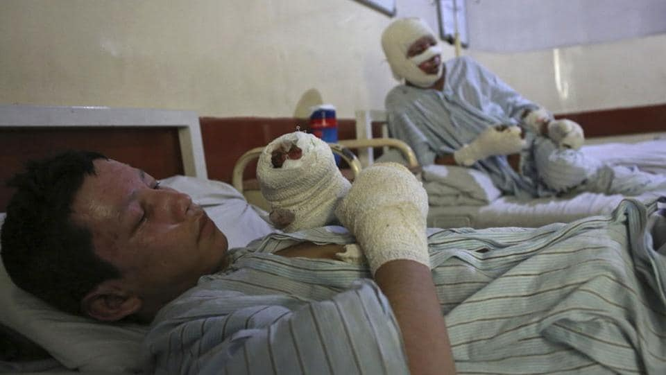Ahmadullah (L), and Mohammad Ali (R), survivors of the December 28 attacks in Kabul are struggling to come to terms with the ordeal they lived through. Such bombings staged by IS in Afghanistan aim to instill terror — by the large numbers of Afghans killed and among those who survive the attacks. (Rahmat Gul / AP)