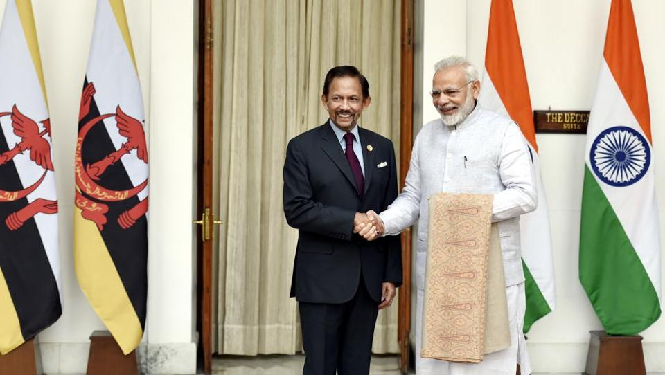 Prime Minister Narendra Modi (R) welcomes Sultan of Brunei Haji Hassanal Bolkiah  prior to a bilateral meeting on the sidelines of ASEAN-INDIA Commemorative Summit, in New Delhi on Thursday.