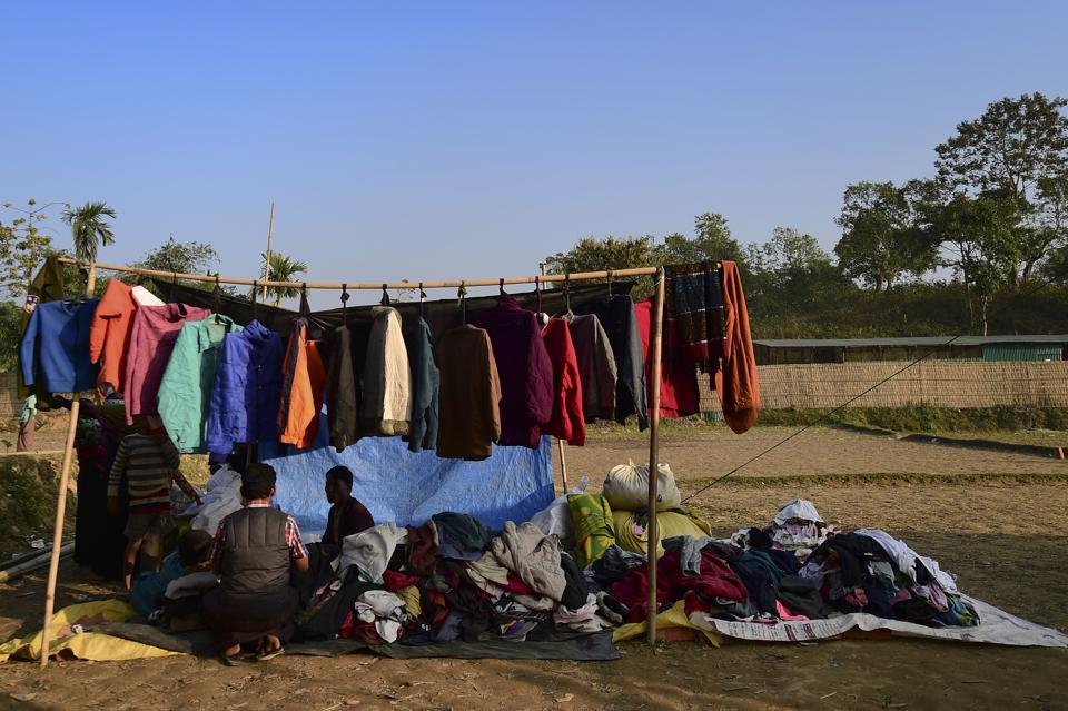 A Rohingya Muslim refugee sells winter clothes at Balukhali refugee camp in Bangladesh's Ukhia district.