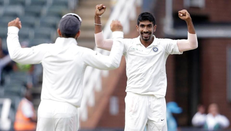 Indian bowler Jasprit Bumrah (R) celebrates the dismissal of South African batsman Lungi Ngidi during the second day of the third test match between South Africa and India at Wanderers cricket ground on January 25, 2018 in Johannesburg.