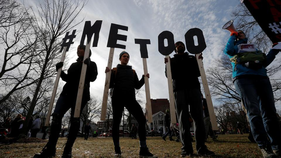 Demonstrators spell out '#METOO' during a women's march in Cambridge, Massachusetts, US, on January 20, 2018.