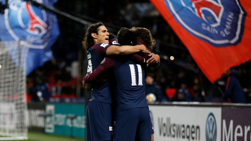 Paris Saint-Germain's French midfielder Adrien Rabiot (R) celebrates with teammates after scoring a goal during the French Cup round of 16 football match between Paris Saint-Germain (PSG) and Guingamp (EAG) at the Parc des Princes stadium in Paris on Wednesday.