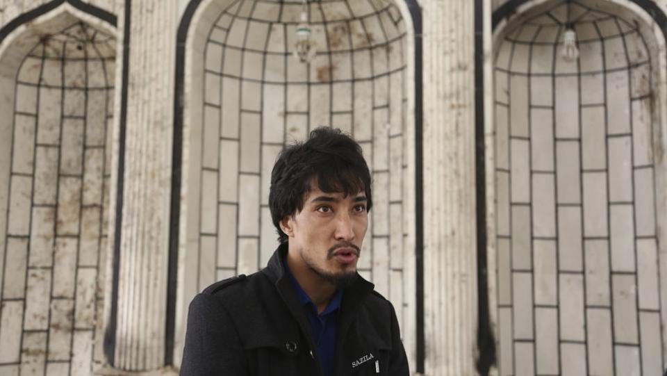 "Hamid Azimi, 28, a reporter talks about his escape during the attack at Tebyan center. He lost his father when an Islamic State bomber killed 57 people at a Shiite mosque in Kabul in October. ""I am so scared now, if there is a gathering somewhere, even just 10 to 20 people, I try to leave the place as soon as possible,"" he said. (Rahmat Gul / AP)"