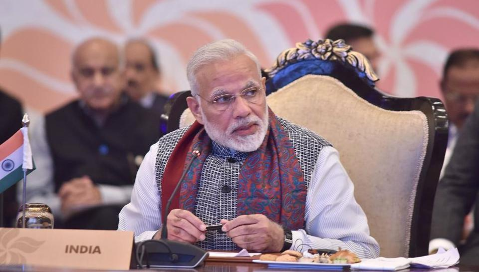 In this photograph released by the Indian PIB, Prime Minister Narendra Modi (C) speaks during the ASEAN India Commemorative Summit in New Delhi.