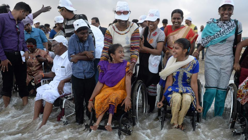 Persons with disabilities enjoy a day out at Elliot's beach in Chennai on December 3, 2017.