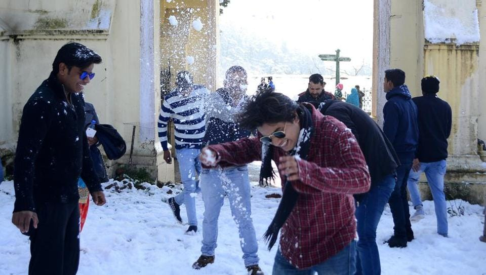 Tourists enjoy snowfall in Shimla on January 24, 2018.