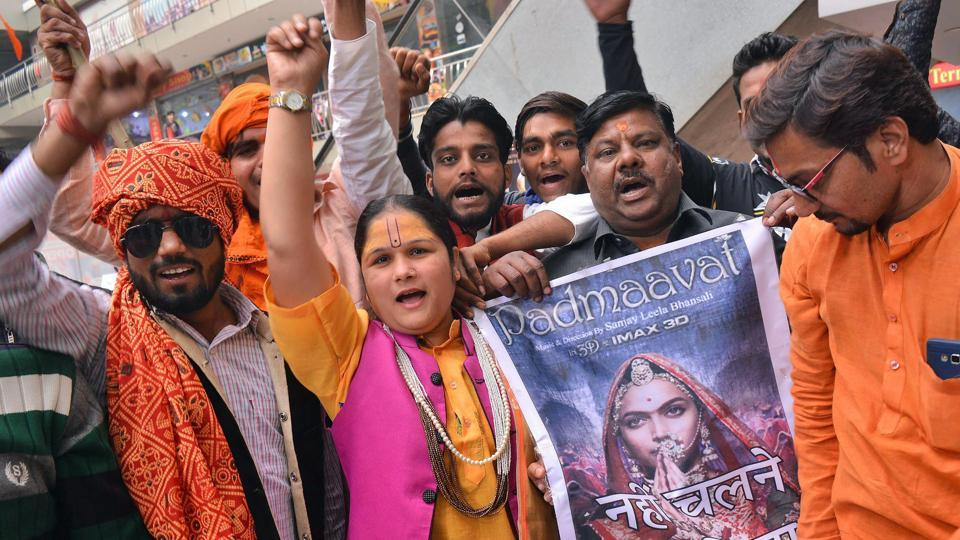 People protest outside a cinema hall against the release of  Padmaavat in Mathura