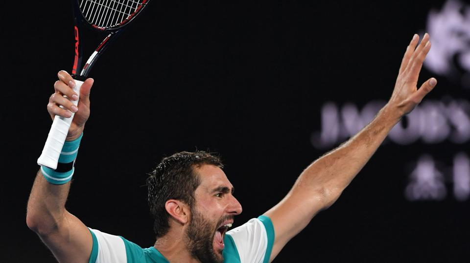 Marin Cilic celebrates beating Kyle Edmund in their men's singles semifinals on day 11 of the Australian Open tennis tournament in Melbourne on Thursday.