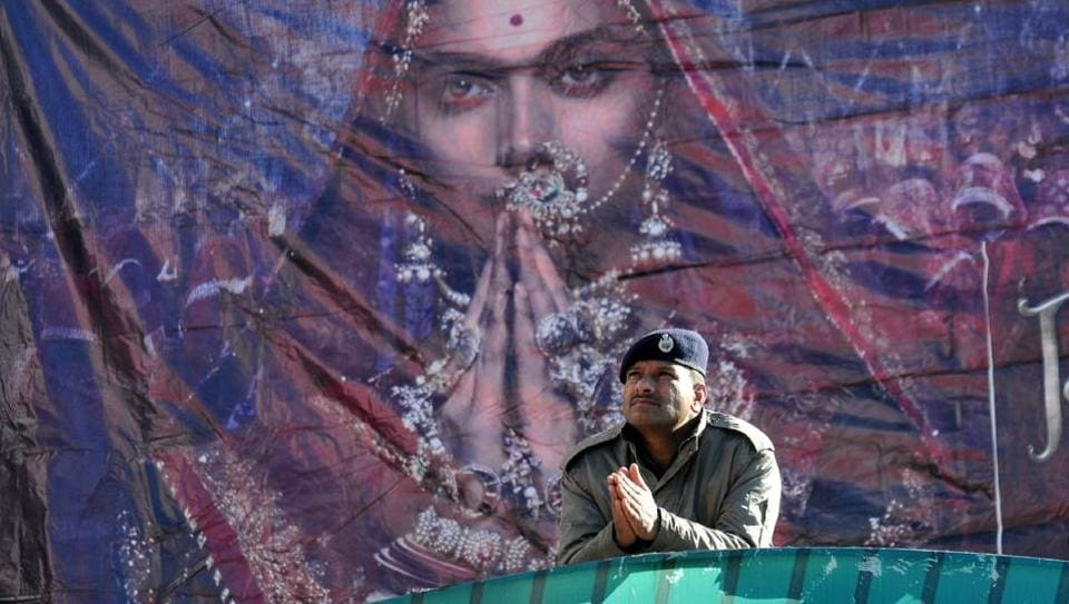 A policeman gestures at the entrance of Ritz cinema hall in Shimla on January 25. Most cinema halls in several states shelved plans to screen Sanjay Leela Bhansali's magnum opus Padmaavat as the controversial film on legendary queen Padmini opened across the country on Thursday amid violent protests by Rajput organisations protesting alleged distortion of history. (AFP)