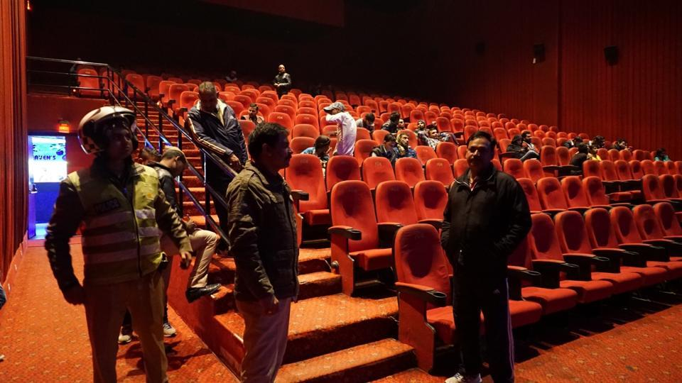 Policemen stand guard on Thursday inside a Varanasi cinema hall screening Padmaavat.