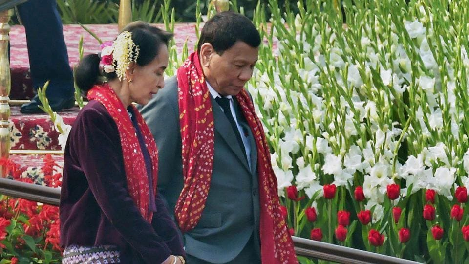 Myanmar's state counsellor Ang San Suu Kyi and Philippine President Rodrigo Roa Duterte leave after attending the Republic Day Parade in New Delhi on January 26, 2018.