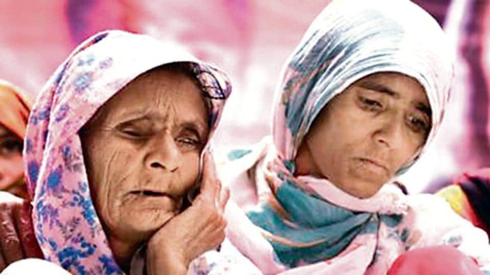 Anguri Begum, mother of lynching victim Pehlu Khan, sits on a dharna, demanding justice for her son.