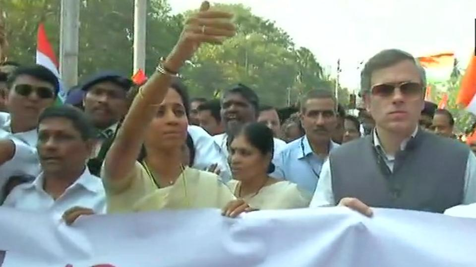 """NCP's Supriya Sule and NC leader Omar Obdullah at the """"Save Constitution"""" march in Mumbai on Friday."""