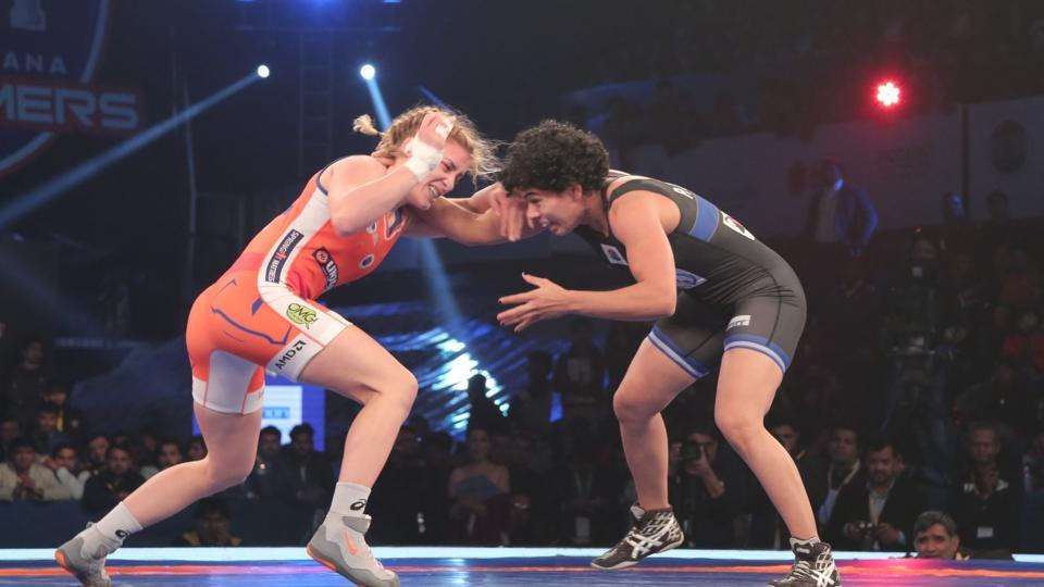 Punjab Royals' Pooja Dhanda (right) in action against Helen Maroulis of Haryana Hammers during the final of the Pro Wrestling League at Siri Fort Stadium in New Delhi. Pooja bet Helen 3-2.
