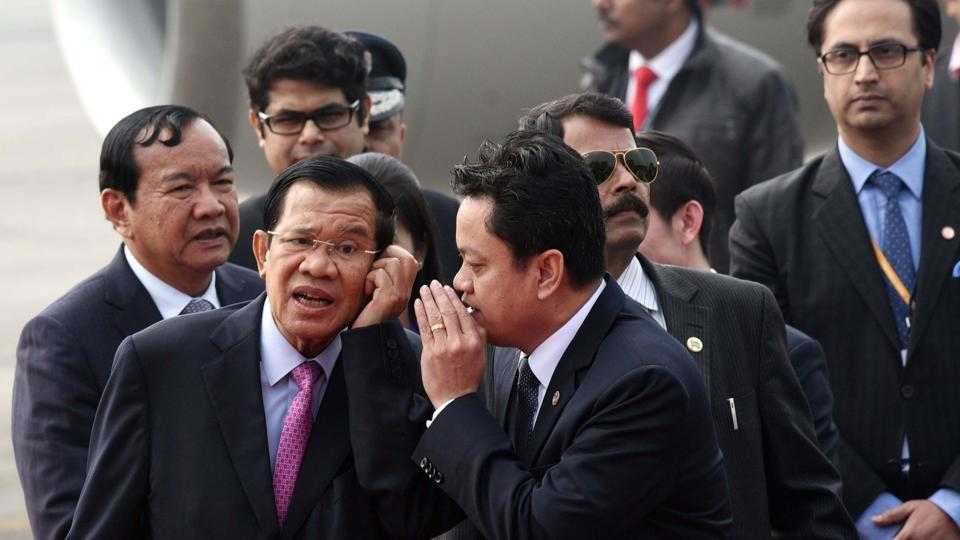 Prime Minister of Cambodia Hun Sen (L) interacts with an official after arriving at Air Force Station Palam for the Association of Southeast Asian Nations (ASEAN) commemorative summit, in New Delhi on Wednesday. (Arvind Yadav/HT Photo)