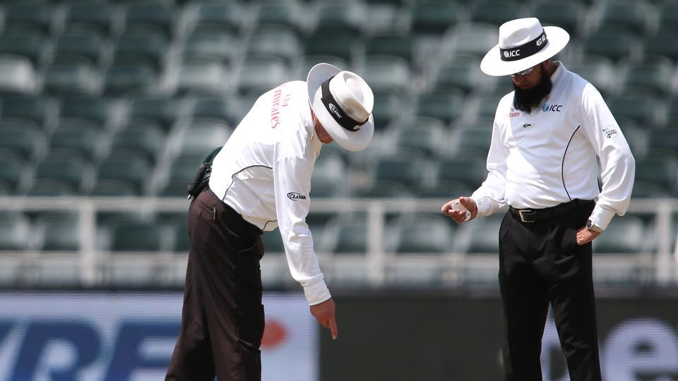 Umpires Ian Gould and Aleem Dar discuss an area on the pitch during the third day of the third Test match between South Africa and India at the Wanderers Stadium in Johannesburg. Catch highlights of India vs South Africa, 3rd Test day 3 here
