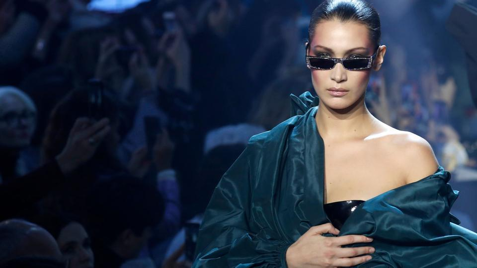 Bella Hadid presents a creation by Alexandre Vauthier during the 2018 spring/summer Haute Couture collection show in Paris. The Paris Haute Couture Fashion Week returned this year, drawing out fashion's highest echelon for a week long extravaganza of the most imaginative, quirky and at times outright bizarre creations from Parisian ateliers and the minds behind them. (Francois Guillot / AFP)