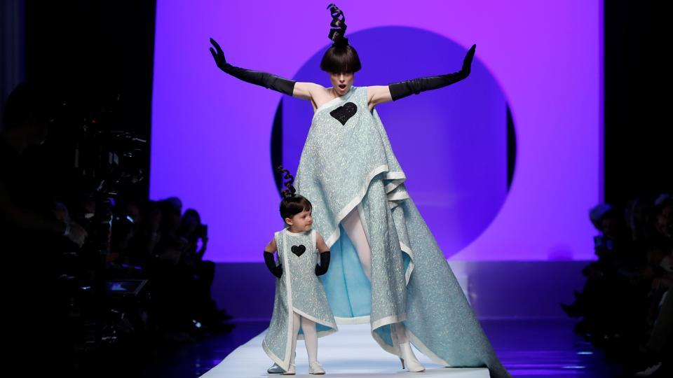 Some during the week struck over-the-top poses as they went, like model Coco Rocha, who had spectators swooning as she took to the catwalk with her two-year-old daughter, dressed identically in an asymetric baby-blue gown. (Gonzales Fuentes / REUTERS)