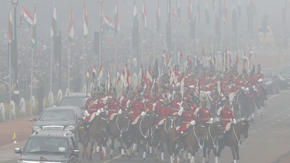 President's horse mounted bodyguards are seen through the morning fog as they escort the President arriving for the Republic Day parade in New Delhi.