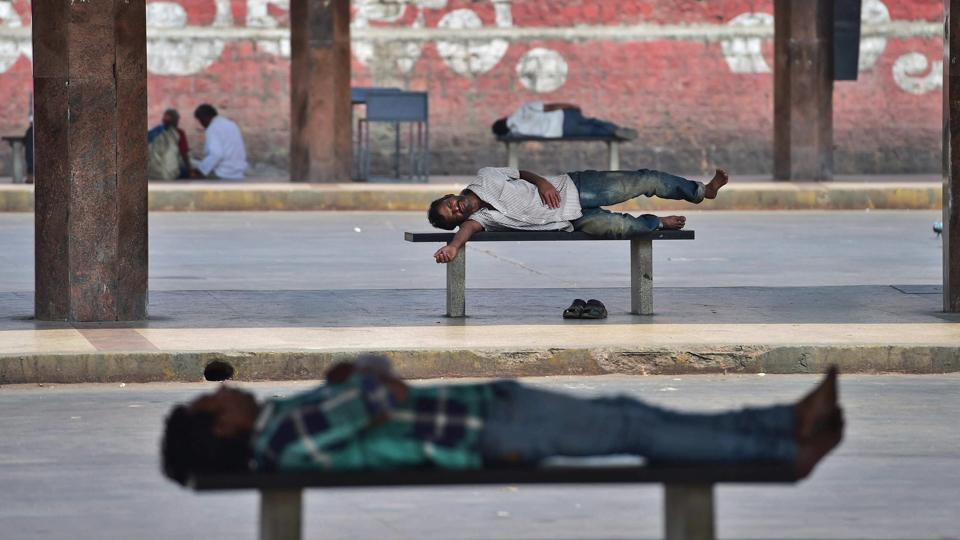 People rest up at Majestic Bus Stand during a Karnataka Bandh in Bengaluru on Thursday. Pro-Kannada organisations called a day-long statewide bandh on the issue of Mahadayi water sharing between the states of Karnataka and Goa.  (PTI)