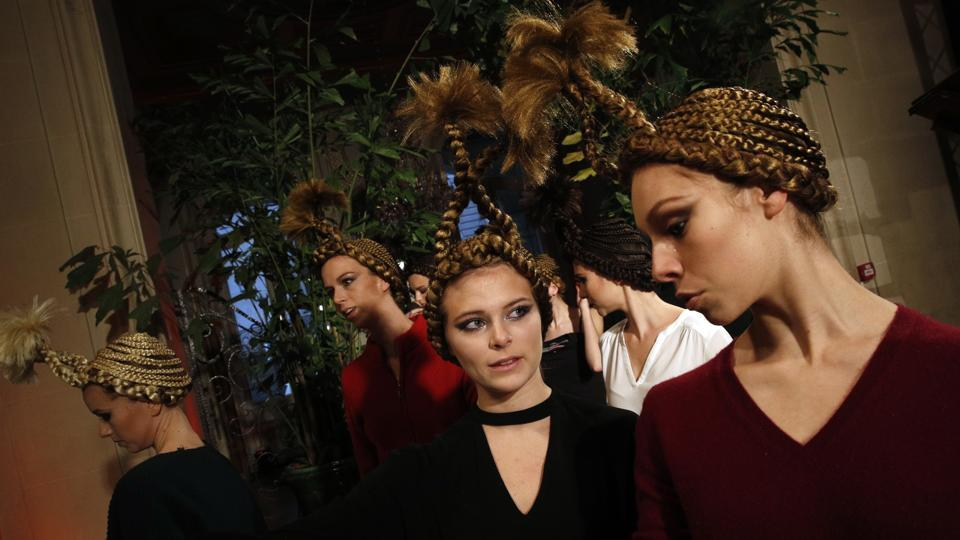 Models wait backstage in a lush, tropical themed setup before the Franck Sorbier presentation. (Christophe Ena / AP)