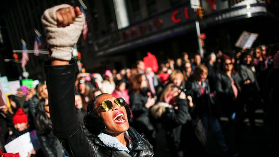 A woman shouts slogans during the Women's March in New York City on January 20, 2018, as protestors took to the streets across the United States, hoisting anti-Trump placards, banging drums and donning pink hats for a second edition opposing the President -- one year to the day of his inauguration. (Kena Betancur / AFP)
