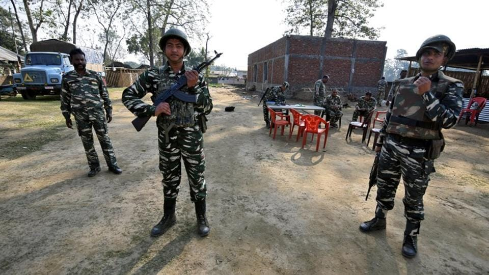 CRPF personnel stand guard in Assam. A 48-hour Dima Hasao district bandh was called by a number of groups to protest police firing at a group of protesters on Thursday.