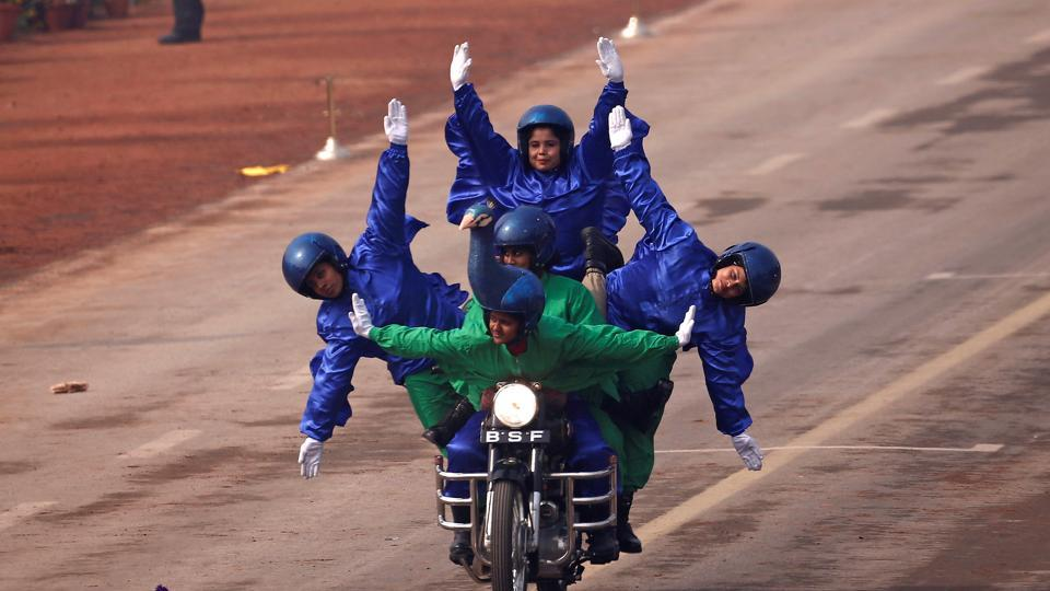 The Indian Border Security Force Daredevils women motorcycle riders perform during the Republic Day parade in New Delhi on Friday.