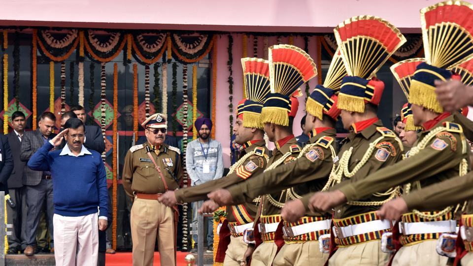 Delhi Chief Minister Arvind Kejriwal greets Delhi police personnel with a salute at Chhatrasal Stadium in New Delhi on Thursday. (Sonu Mehta/HT Photo)