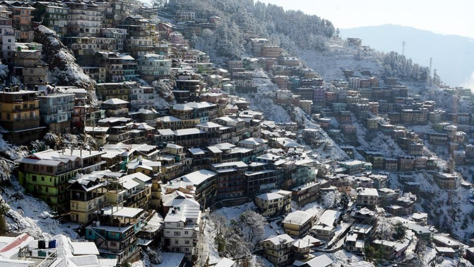 A view of snow covered roofs after the first snowfall of the year at Sanjauli, Shimla on Wednesday. (Deepak Sansta / HT Photo)