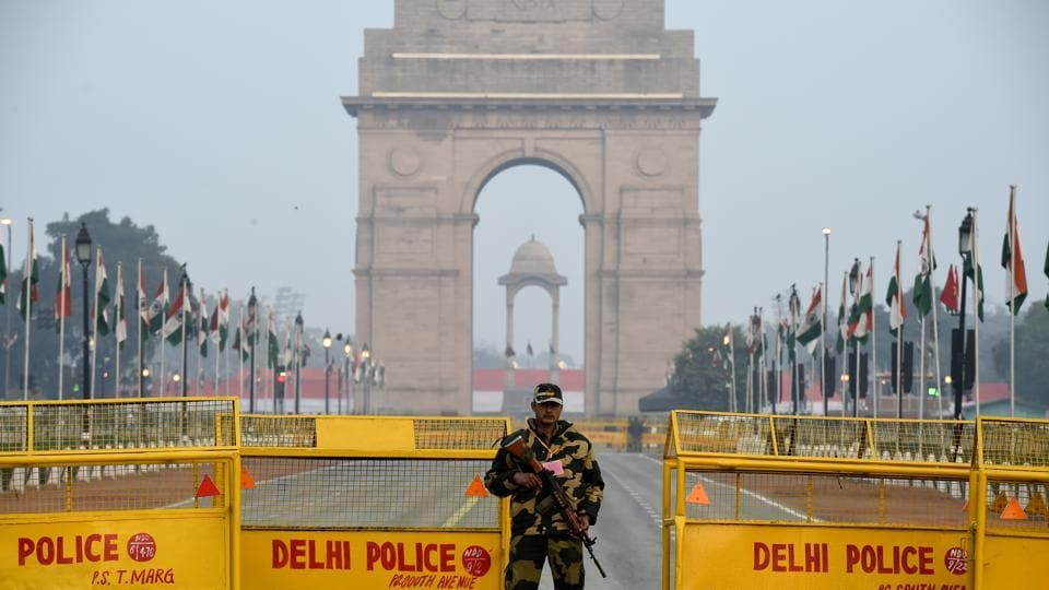 Security personnel stands guard at Rajpath on the eve of Republic Day in New Delhi.