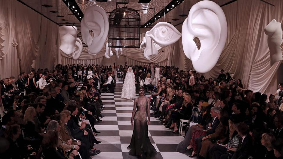 Christian Dior went all surrealist in the first big show of the haute couture week, opening on a chequerboard set worthy of a Salvador Dali daydream, with plaster casts of ears, noses and eyes hanging from a mirrored ceiling. (Francois Guillot / AFP)