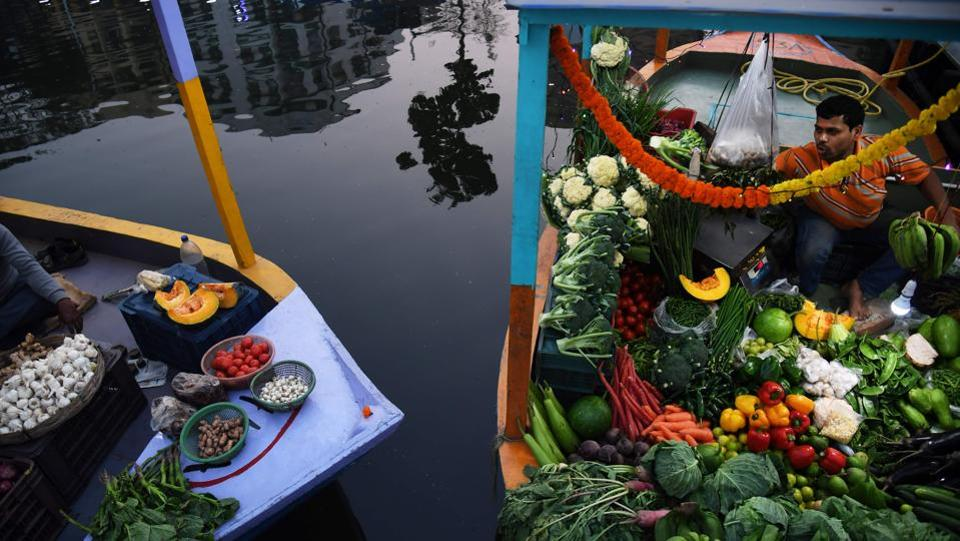 A shopkeeper waits for customers in a boat after the opening of the floating market in Kolkata on  Wednesday. A market modelled on a floating market in the Thai capital Bangkok has opened in Kolkata, employing over 200 stall owners affected by the widening of the Eastern Metropolitan Bypass. (Dibyangshu Sarkar / AFP)