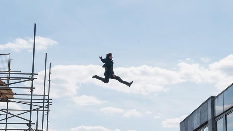 Tom Cruise leaps of a building while shooting Mission: Impossible - Fallout.