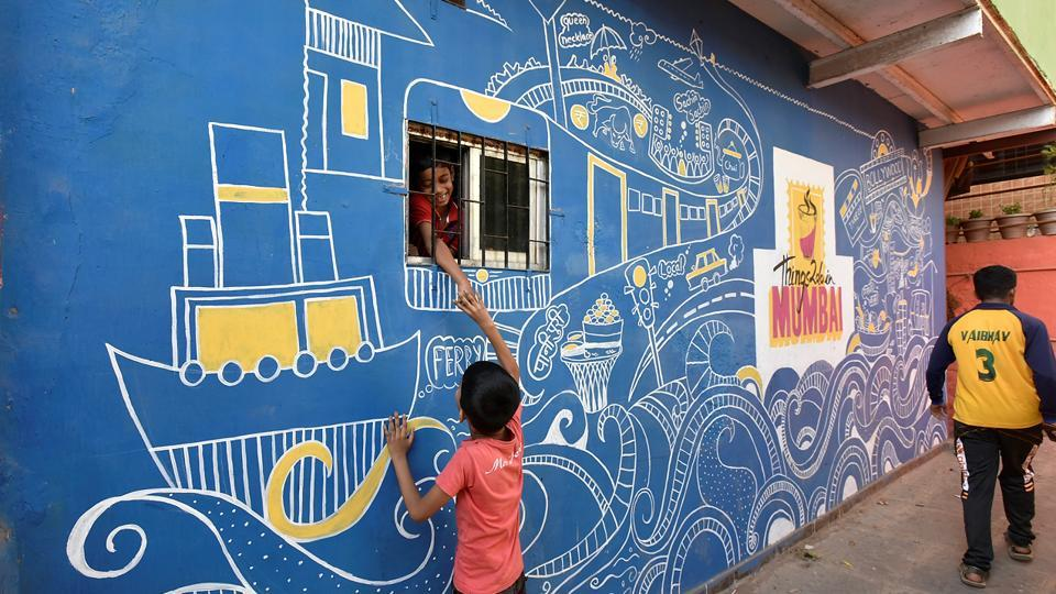 Asalpha is the first slum locality in the city to undergo this colourful transformation. (Kunal Patil/HT Photo)