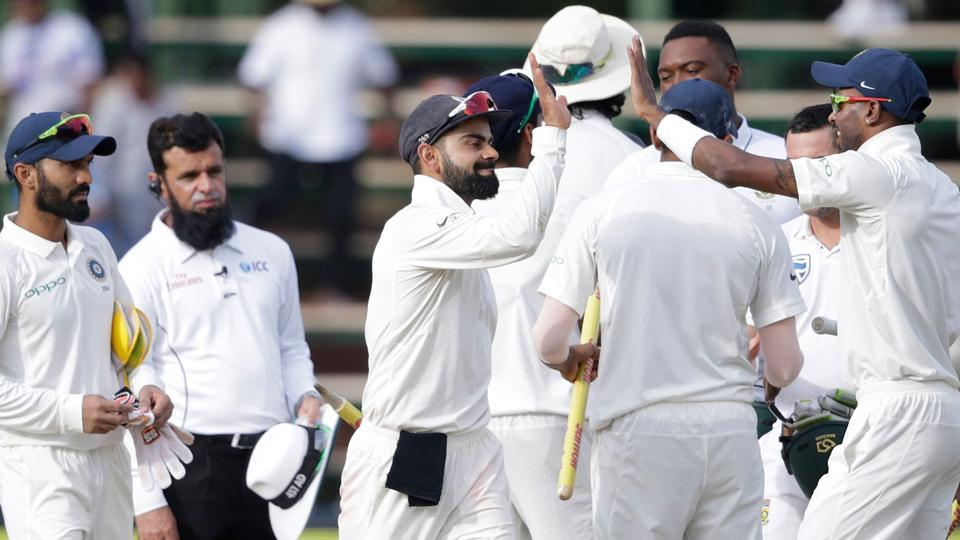 Indian cricket team captain Virat Kohli celebrates with teammates after winning the third Test against South Africa cricket team at Wanderers cricket ground in Johannesburg on Saturday