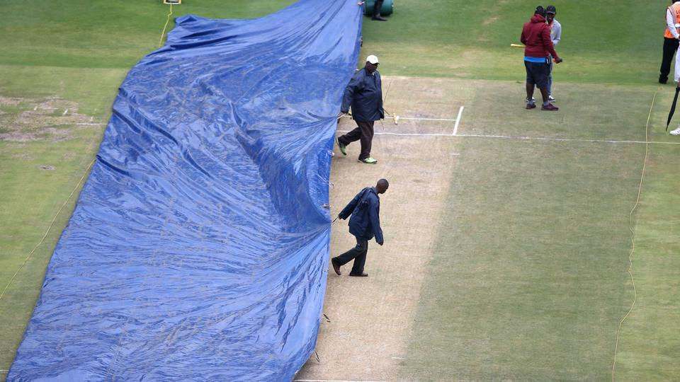 Ground staff bring the covers on before the start of the fourth day. The day started almost one hour late. (BCCI)
