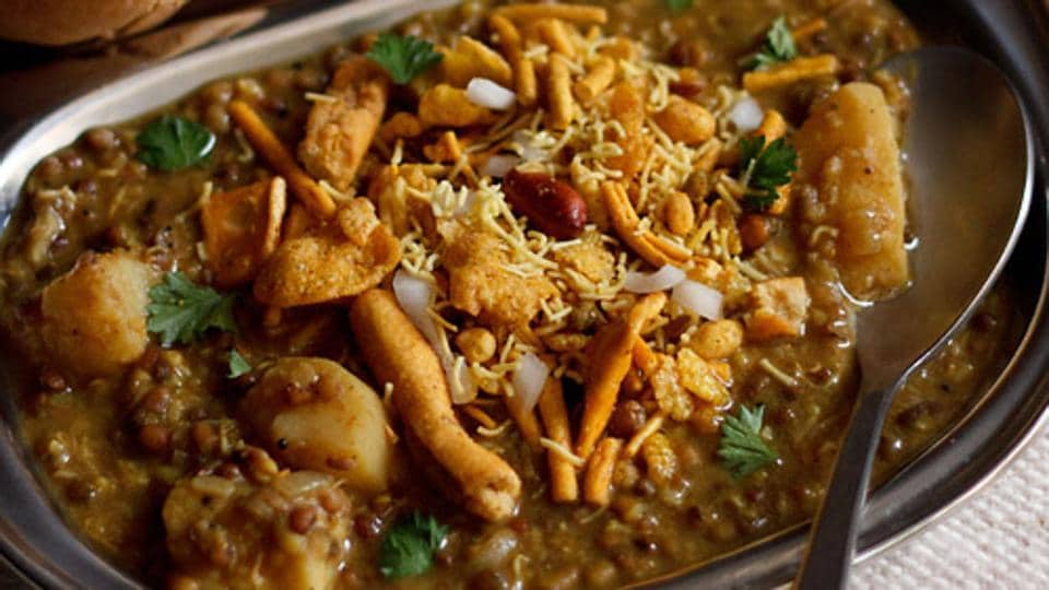 Misal is a popular Maharashtrian snacks comprising sprouts, moth beans, farsan, tomatoes, onions, boiled potatoes, lemon and coriander.