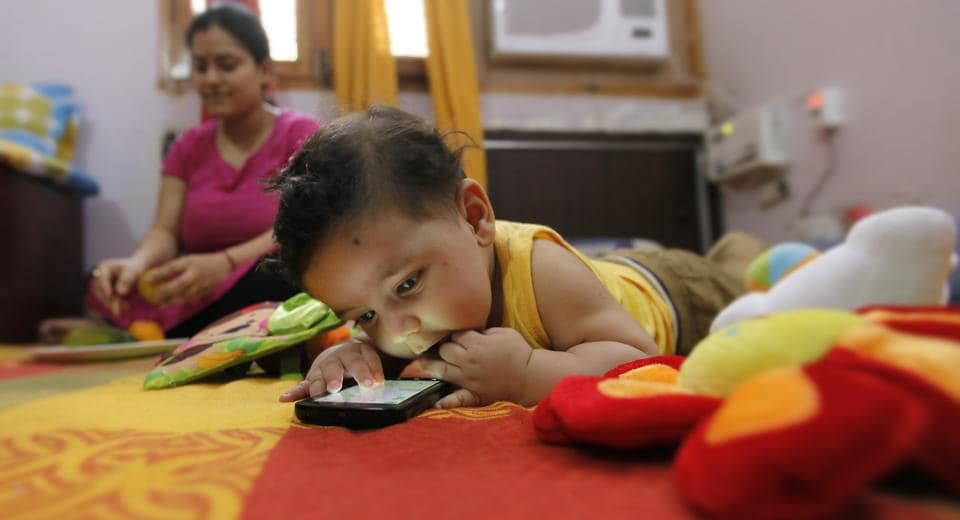 Aayansh has been hooked to his mother's smartphone since he was five months old. Now three, he has trouble understanding why he can't take it to nursery school. 'He puts it down only at bedtime,' says his mother.