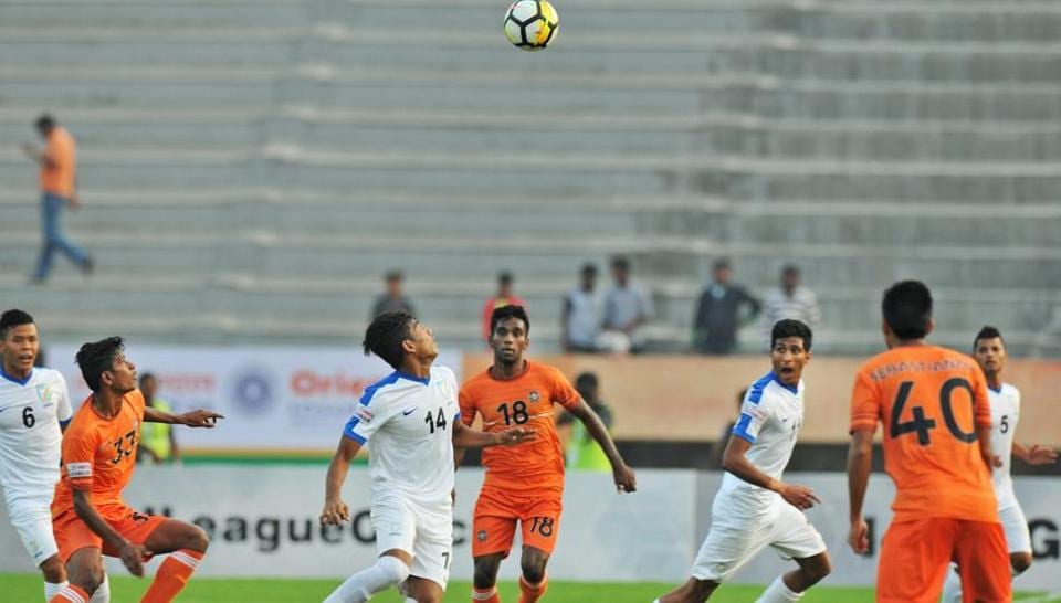 Chennai City FC and Indian Arrows players vie for the ball during their I-League match at Nehru Stadium in Coimbatore on Saturday.