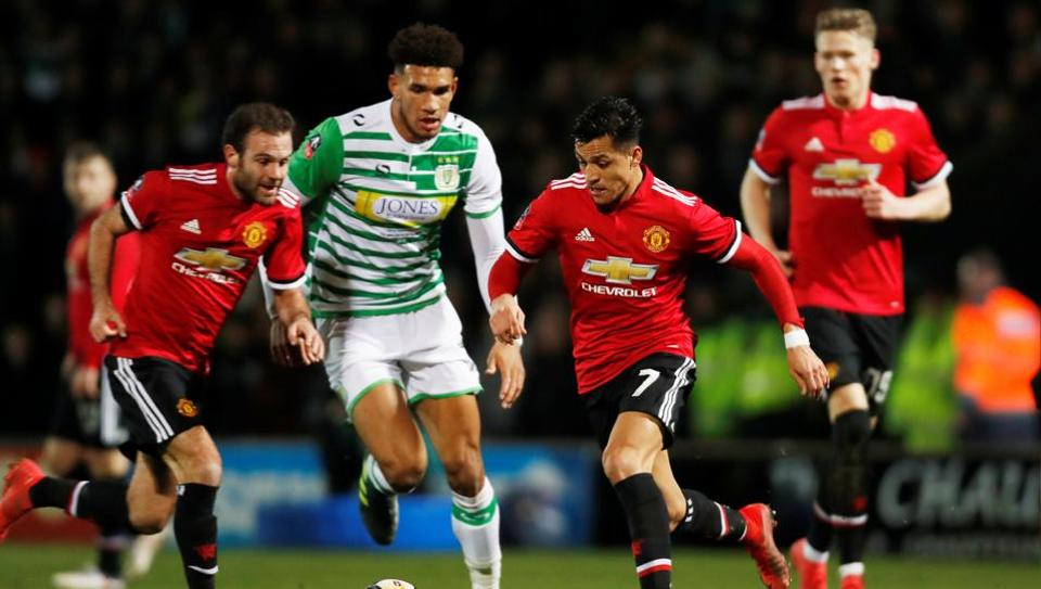 Manchester United's Alexis Sanchez and Juan Mata in action with Yeovil Town's Omar Sowunmi in the FACup on Friday.