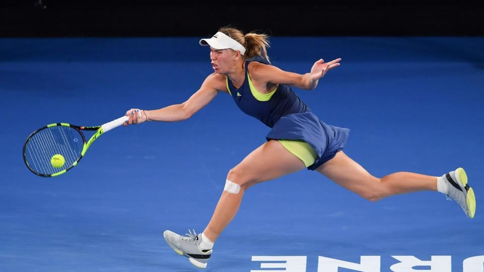Caroline Wozniacki in full flow during the seesaw Australian Open women's singles final against Simona Halep on Saturday.  (AFP)